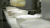 Anglia praca na produkcji masła w fabryce- Caerphilly, Wielka Brytania